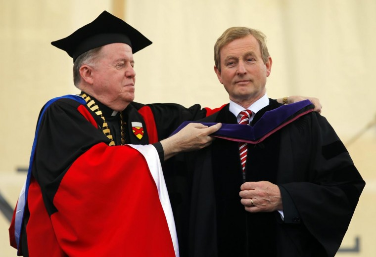 Irish Prime Minister Enda Kenny receives an honorary Doctor of Laws degree from Boston College president William Leahy (L) during Commencement Exercises at Boston College in Boston, Massachusetts May 20, 2013. (Brian Snyder/Reuters)