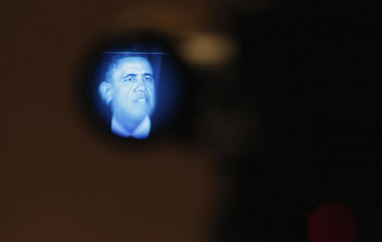 U.S. President Barack Obama is pictured in the electronic viewfinder of a television camera as he speaks at a Democratic Party fundraiser at the Waldorf Astoria hotel in New York, May 13, 2013. Obama attended several fundraisers in Manhattan on Monday. (Jason Reed/Reuters)