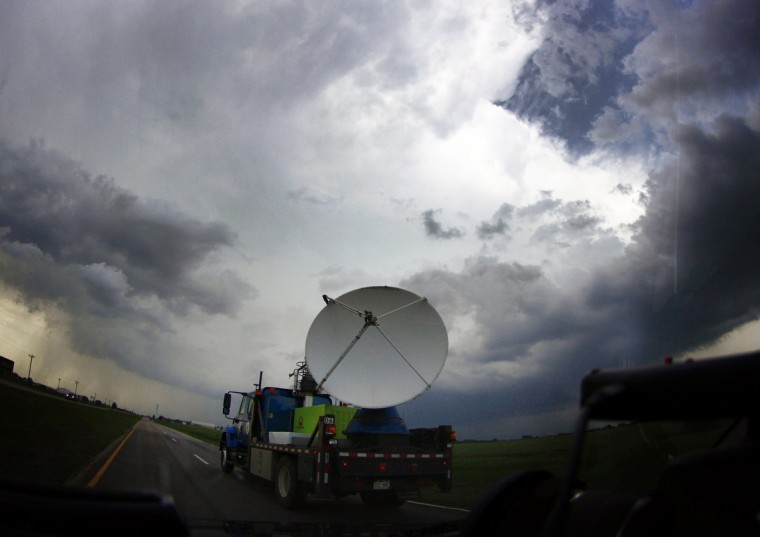 A National Oceanic and Atmospheric Administration (NOAA)'s mobile doppler radar mounted on the back of a truck tracks a tornadic thunderstorm passing over Clearwater, in Kansas. (Gene Blevins/Reuters)