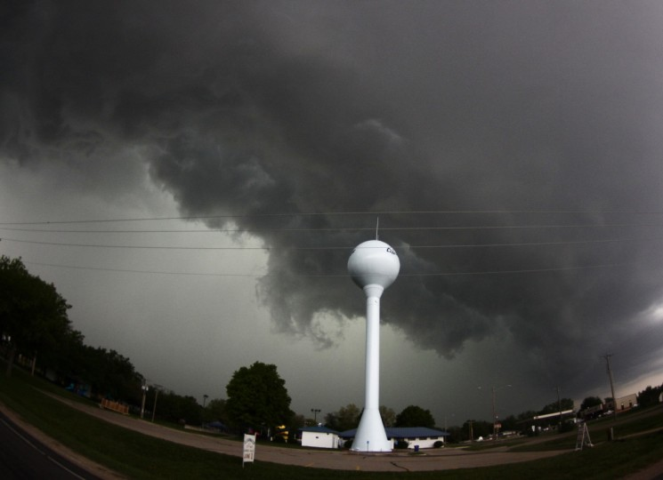 A tornadic thunderstorm passes over Clearwater, in Kansas. A massive storm front swept north through the central United States. (Gene Blevins/Reuters)