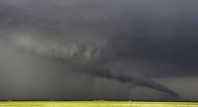 The funnel of a tornadic thunderstorm almost touches the ground near South Haven, in Kansas May 19, 2013. (Gene Blevins/Reuters)