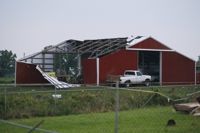 A barn's roof and siding is torn off after a tornado swept through west of Shawnee, Oklahoma. A (Bill Waugh/Reuters photo)