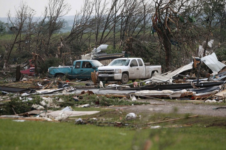 Vehicles are seen amongst storm debris, which is what is left of a mobile home park destroyed by a tornado, west of Shawnee, Oklahoma. (Bill Waugh/Reuters photo)