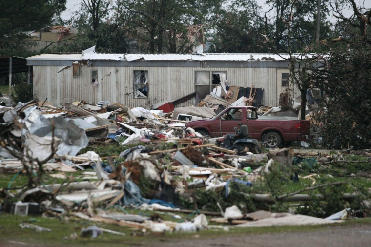 Debris is seen at a mobile home park which was destroyed by a tornado on Sunday, west of Shawnee, Oklahoma. A tornado half a mile wide struck near Oklahoma City part of a massive storm front that hammered the central United States. News reports said at least one person had died. (Bill Waugh/Reuters photo)