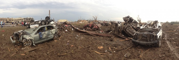 Overturned cars are seen after a massive tornado touched down near Oklahoma City, Oklahoma May 20, 2013. A devastating tornado struck an Oklahoma City suburb on Monday and the National Weather Service urged residents to immediately take cover as a large storm system in the middle of the country threatened to pummel as many as 10 states. (Richard Rowe/Reuters)