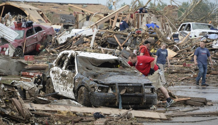 A damaged police car is seen after a tornado struck Moore, Oklahoma, May 20, 2013. A 2-mile-wide (3-km-wide) tornado tore through the Oklahoma City suburb of Moore on Monday. (Gene Blevins/Reuters)