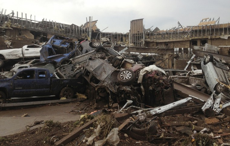 Overturned cars are seen after a huge tornado touched down in the town of Moore, near Oklahoma City, Oklahoma May 20, 2013. The huge tornado that struck the town of Moore, Oklahoma, on Monday was given a preliminary rating of at least EF4, or the second highest strength level, with winds of up to 200 miles per hour (321 kph), a U.S. government agency said. (Richard Rowe/Reuters)