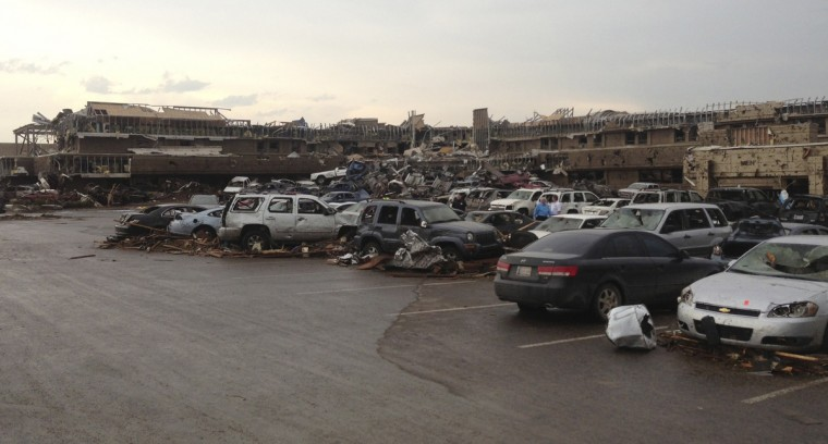 A shopping center and parking lot are filled with debris after a huge tornado struck in Moore, Oklahoma near Oklahoma City, Oklahoma May 20, 2013. The huge tornado that struck the town of Moore, Oklahoma, on Monday was given a preliminary rating of at least EF4, or the second highest strength level, with winds of up to 200 miles per hour (321 kph), a U.S. government agency said. (Richard Rowe/Reuters)