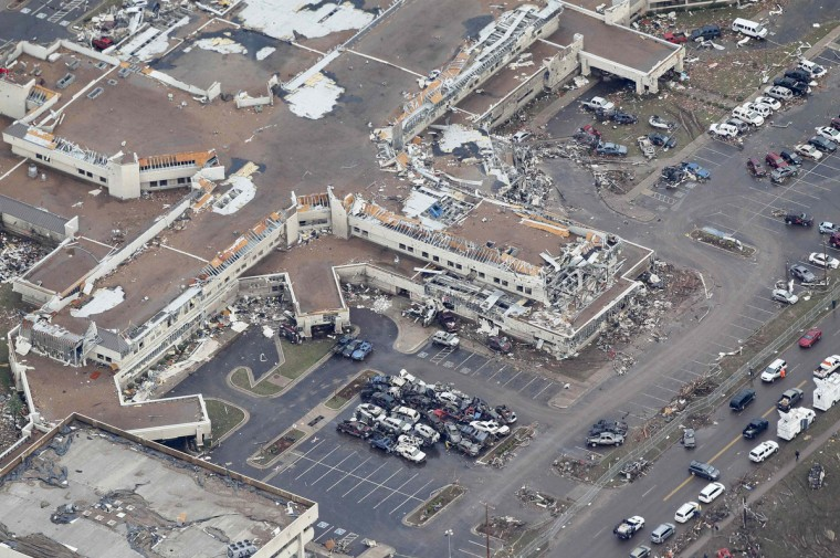 An aerial view of damage at Moore Medical Center in Moore, Oklahoma May 21, 2013, in the aftermath of a tornado which ravaged the suburb of Oklahoma City. Rescuers went building to building in search of victims and thousands of survivors were homeless on Tuesday, a day after a massive tornado tore through Moore, wiping out whole blocks of homes and killing at least 24 people. Seven children died at the school which took a direct hit in the deadliest tornado to hit the United States in two years. (Rick Wilking/Reuters)