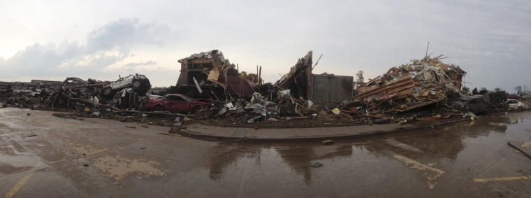 Destroyed buildings and overturned cars are seen after a huge tornado struck Moore, Oklahoma, near Oklahoma City, May 20, 2013. The powerful tornado that struck the town of Moore, Oklahoma, on Monday was given a preliminary rating of at least EF4, or the second highest strength level, with winds of up to 200 miles per hour (321 kph), a U.S. government agency said. (Richard Rowe/Reuters)