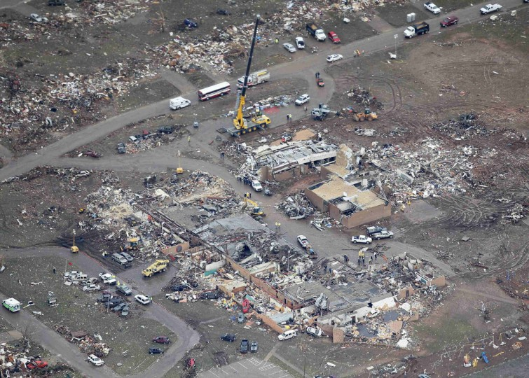 An aerial view of crews working the scene at Plaza Towers Elementary School in Moore, Oklahoma May 21, 2013, in the aftermath of a tornado which ravaged the suburb of Oklahoma City. Rescuers went building to building in search of victims and thousands of survivors were homeless on Tuesday, a day after a massive tornado tore through Moore, wiping out whole blocks of homes and killing at least 24 people. Seven children died at the school which took a direct hit in the deadliest tornado to hit the United States in two years. (Rick Wilking/Reuters)
