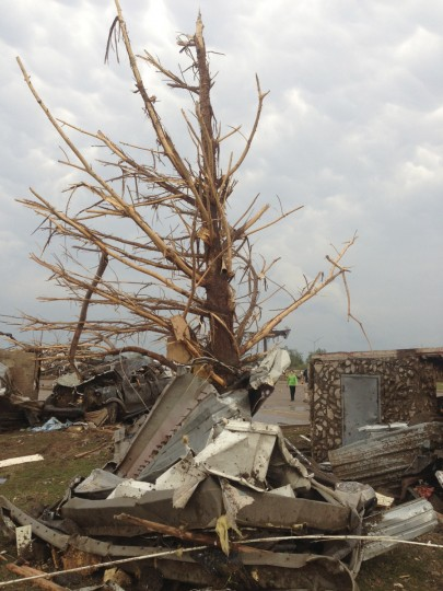 A shredded tree stands amid debris after a massive tornado touched down in the town of Moore, near Oklahoma City, Oklahoma May 20, 2013. A huge tornado with winds of up to 200 miles per hour (320 kph) tore through the Oklahoma City suburb of Moore on Monday, ripping up at least two schools and leaving a wake of tangled wreckage as a dangerous storm system threatened as many as 10 U.S. states. (Richard Rowe/Reuters)