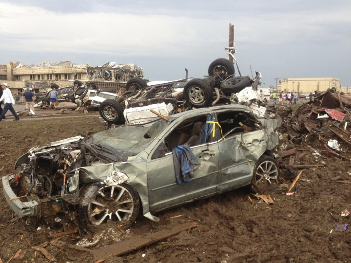 Overturned cars are seen from destruction from a huge tornado near Oklahoma City, Oklahoma May 20, 2013. A huge tornado touched down on Monday near Oklahoma City, and the National Weather Service urged residents to immediately take cover as a massive storm system in the middle of the country threatened to pummel as many as 10 states. (Richard Rowe/Reuters)