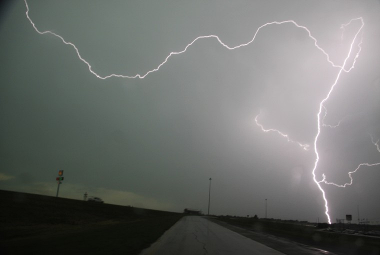 Lightning strikes over interstate 35 near Moore, Oklahoma May 21, 2013. Thunderstorms and lightning slowed the rescue effort on Tuesday, but 101 people had been pulled from the debris alive, Oklahoma Highway Patrol spokeswoman Betsy Randolph said. (Gene Blevins/Reuters)