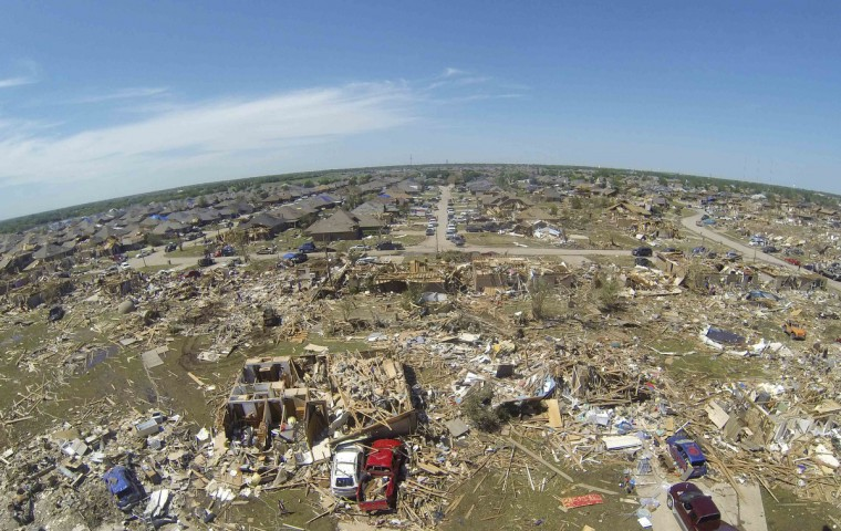 Intact homes (upper left) stand next to totally destroyed dwellings showing the path of the May 20 tornado in Oklahoma City, Oklahoma. Rescue workers with sniffer dogs picked through the ruins on Wednesday to ensure no survivors remained buried after a deadly tornado left thousands homeless and trying to salvage what was left of their belongings. Curvature of horizon in the photo is due to an ultra-wide angle lens. (Rick Wilking/Reuters)