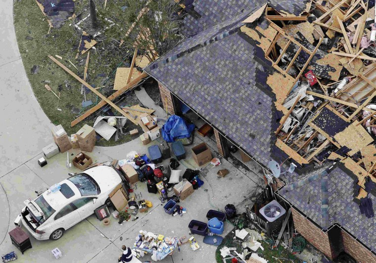 An aerial view shows the damage after tornados swept through Hood County, Texas May 16, 2013. At least six people were killed and about 100 injured on Wednesday as three tornadoes ripped through a stretch of Texas near the Dallas-Fort Worth area, destroying a number of homes, authorities said. (Brandon Wade/Reuters)
