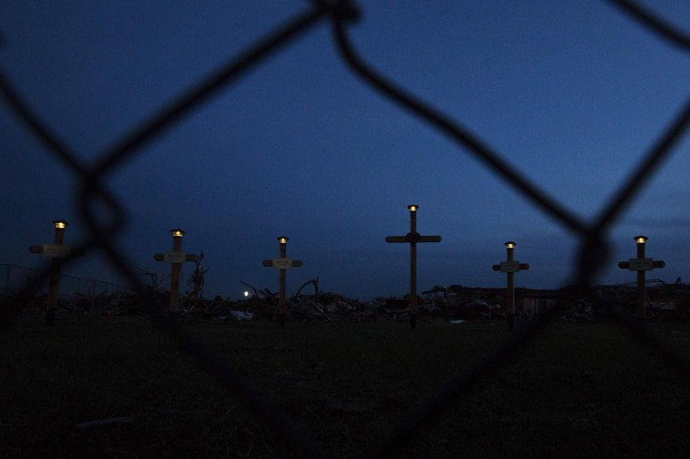 Lights shine on the tops of crosses making up a memorial outside the Plaza Towers elementary school where seven children died and several students and teachers were injured by the May 20 afternoon tornado in Moore, Oklahoma May 26, 2013. The tornado was the strongest in the United States in nearly two years and cut a path of destruction 17 miles (27 km) long and 1.3 (2 km) miles wide. (Lucas Jackson/Reuters)
