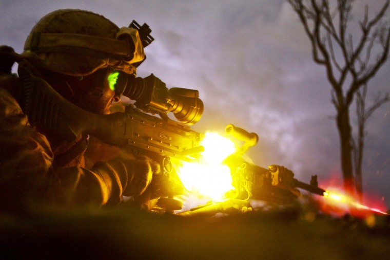 U.S. Marines Private First Class Sebastian Rodriguez, a machine gunner from Weapons Platoon, Lima Company, 3rd Battalion, 3rd Marine Regiment, Marine Rotational Force Darwin (MRF-D), fires a M240 machine gun during a night squad-attack exercise at Kangaroo Flats Training Area in Australia. (Sgt. Sarah Fiocco/via Reuters)