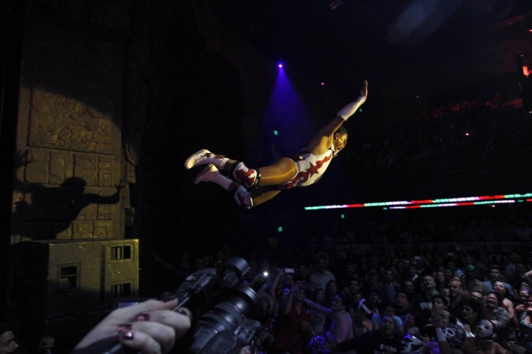 Lucha libre wrestler Cassandro leaps into the audience during the Lucha VaVOOM show as part of a Cinco de Mayo celebration at the Mayan theatre in Los Angeles, California May 5, 2013. (Mario Anzuoni/Reuters)