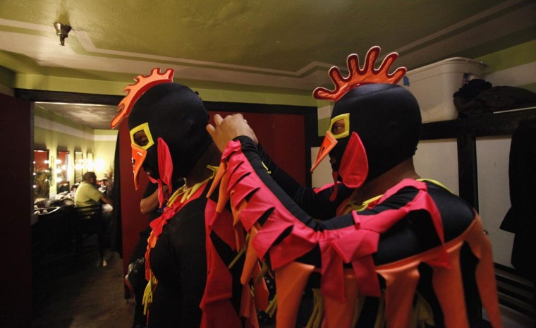 Lucha libre wrestlers The Crazy Chickens prepare backstage before the Lucha VaVOOM show as part of a Cinco de Mayo celebration at the Mayan theatre in Los Angeles, California May 5, 2013. (Mario Anzuoni/Reuters)