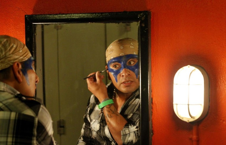 A performer applies makeup backstage before the Lucha VaVOOM show as part of a Cinco de Mayo celebration at the Mayan theatre in Los Angeles, California May 5, 2013. (Mario Anzuoni/Reuters)