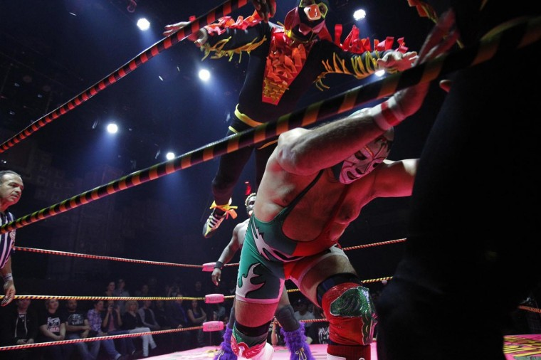 Lucha libre wrestlers Dr. Maldad (bottom R) and a member of The Crazy Chickens fight during the Lucha VaVOOM show as part of a Cinco de Mayo celebration at the Mayan Theatre in Los Angeles, California May 5, 2013. (Mario Anzuoni/Reuters)