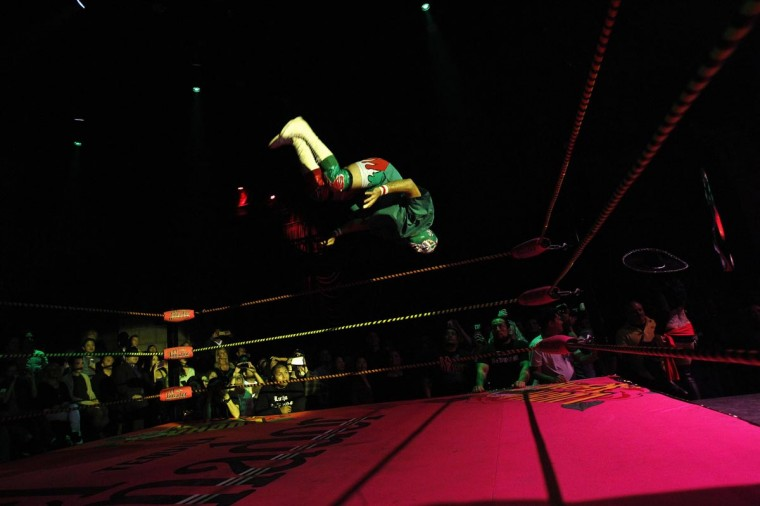 Lucha libre wrestler Dr. Maldad leaps in midair during the Lucha VaVOOM show as part of a Cinco de Mayo celebration at the Mayan Theatre in Los Angeles, California May 5, 2013. (Mario Anzuoni/Reuters)