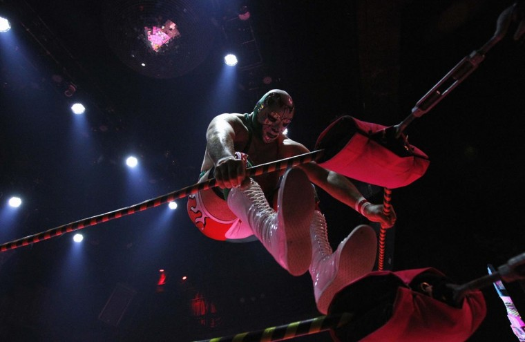 Lucha libre wrestler Dr. Maldad warms up ringside during the Lucha VaVOOM show as part of a Cinco de Mayo celebration at the Mayan Theatre in Los Angeles, California May 5, 2013. (Mario Anzuoni/Reuters)