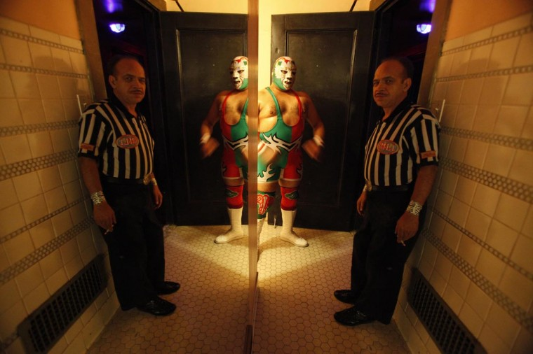 Lucha libre wrestler Dr Maldad and referee Platainitos wait backstage before the Lucha VaVOOM show as part of a Cinco de Mayo celebration at the Mayan theatre in Los Angeles, California May 5, 2013. (Mario Anzuoni/Reuters)
