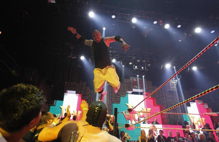 Lucha libre wrestler Lil Cholo leaps off the ring during his fight with Matt Classic (bottom 3rd L) during the Lucha VaVOOM show as part of a Cinco de Mayo celebration at the Mayan Theatre in Los Angeles, California May 5, 2013. (Mario Anzuoni/Reuters)