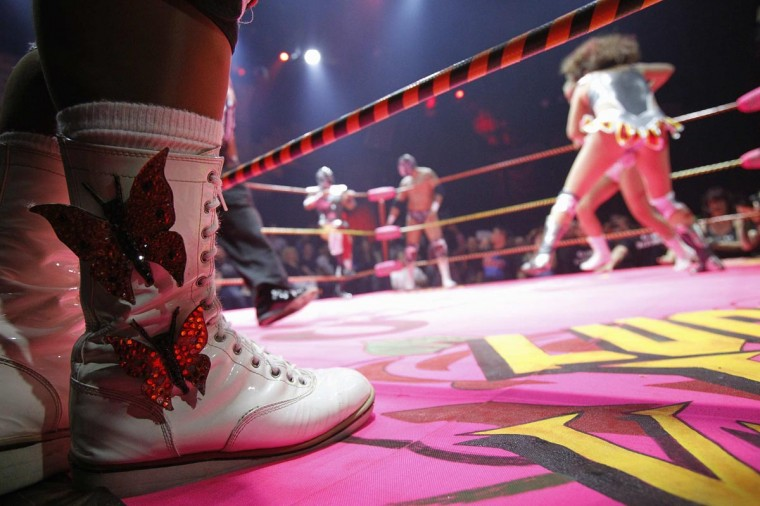 The boots of lucha libre wrestler Cassandro are pictured as he waits ringside during the Lucha VaVOOM show as part of a Cinco de Mayo celebration at the Mayan Theatre in Los Angeles, California May 5, 2013. (Mario Anzuoni/Reuters)