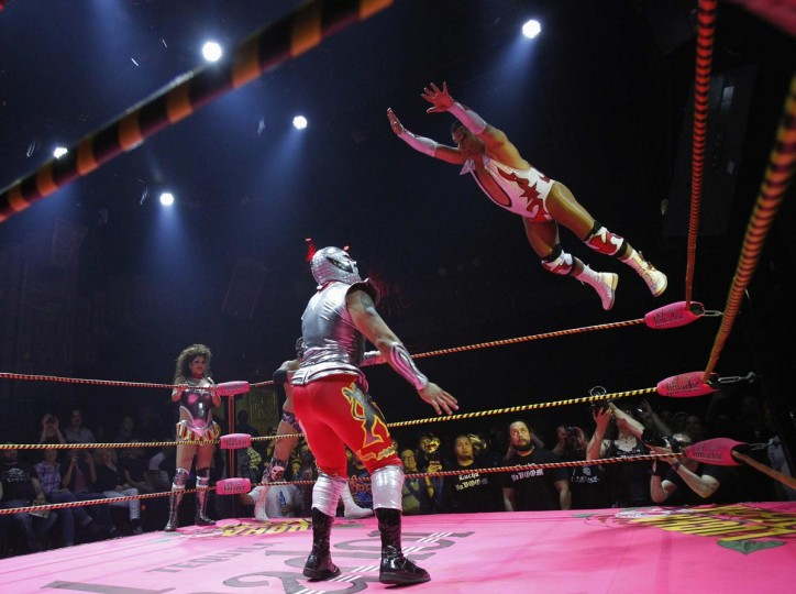 Lucha libre wrestler Cassandro (R) leaps in midair during his fight at the Lucha VaVOOM show as part of a Cinco de Mayo celebration at the Mayan Theatre in Los Angeles, California May 5, 2013. (Mario Anzuoni/Reuters)