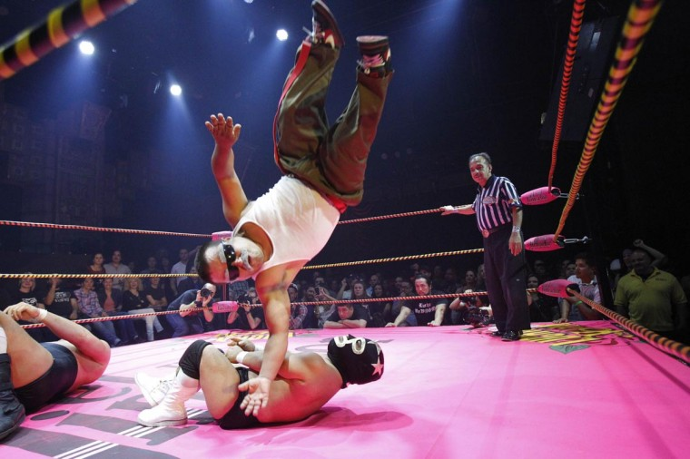 Lucha libre wrestler Cholitito leaps onto Mini Matt Classic during their fight at the Lucha VaVOOM show as part of a Cinco de Mayo celebration at the Mayan theatre in Los Angeles, California May 5, 2013. (Mario Anzuoni/Reuters)