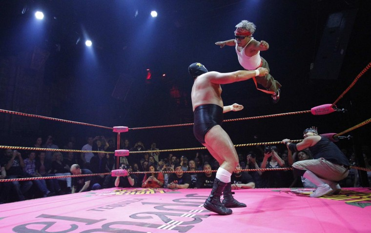 Lucha libre wrestlers Matt Classic (L) and Cholitito fight during the Lucha VaVOOM show as part of a Cinco de Mayo celebration at the Mayan Theatre in Los Angeles, California May 5, 2013. (Mario Anzuoni/Reuters)