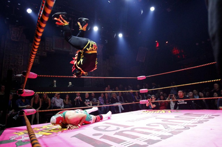 A lucha libre wrestler of The Crazy Chickens leaps in midair while fighting against Dr. Maldad (bottom) during the Lucha VaVOOM show as part of a Cinco de Mayo celebration at the Mayan Theatre in Los Angeles, California May 5, 2013.(Mario Anzuoni/Reuters)