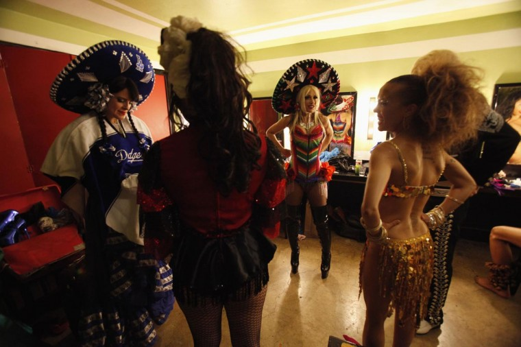Performers get ready backstage before the Lucha VaVOOM show as part of a Cinco de Mayo celebration at the Mayan theatre in Los Angeles, California May 5, 2013. (Mario Anzuoni/Reuters)