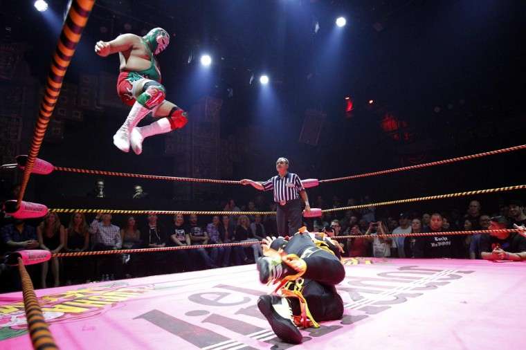 Lucha libre wrestler Dr. Maldad (L) leaps in midair while fighting against a member of The Crazy Chickens during the Lucha VaVOOM show as part of a Cinco de Mayo celebration at the Mayan Theatre in Los Angeles, California May 5, 2013. (Mario Anzuoni/Reuters)