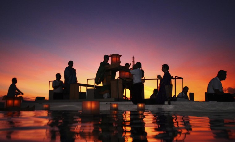 Shinnyo-en Buddhist monks and devotees place lanterns on the water during a ceremony marking remembrance and reflection on Memorial Day, and to honor victims of war, famine, and natural disasters at Ala Moana beach park in Honolulu, Hawaii May 27, 2013. (Hugh Gentry/Reuters)