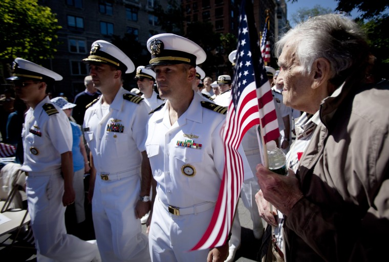 Seymour Kirzner (right) of New York watches as Naval officers file in at the Soldiers and Sailors Monument at the start of a Memorial Day service on the Upper West Side of New York. (Carlo Allegri/Reuters)
