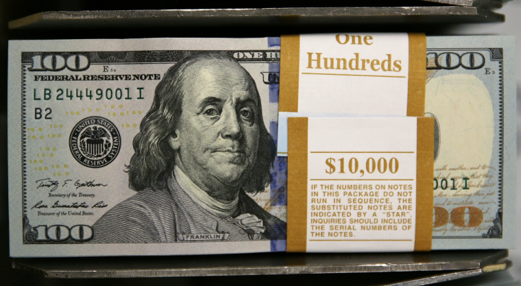Newly redesigned $100 notes lay in stacks at the Bureau of Engraving and Printing on May 20, 2013 in Washington, DC. The one hundred dollar bills will be released this fall and has new security features, such as a duplicating portrait of Benjamin Franklin and microprinting added to make the bill more difficult to counterfeit. (Mark Wilson/Getty Images)