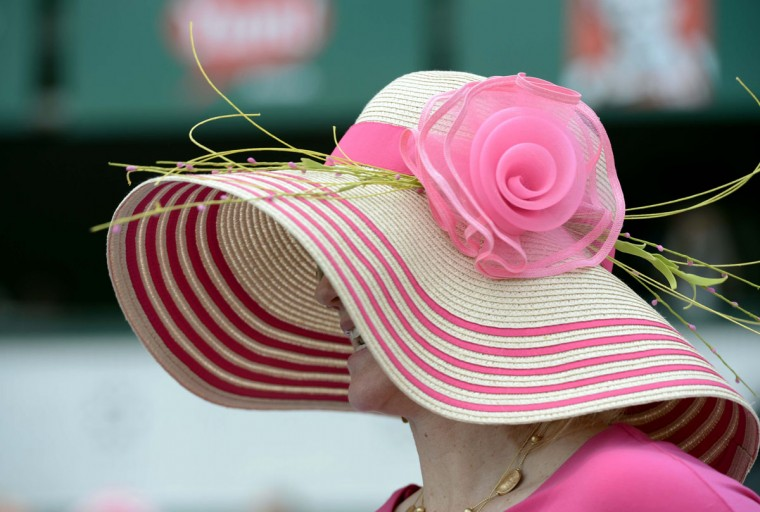 Leslie Garner wears her traditional Derby hat before the 2013 Kentucky Oaks at Churchill Downs. (Jamie Rhodes/USA TODAY Sports)