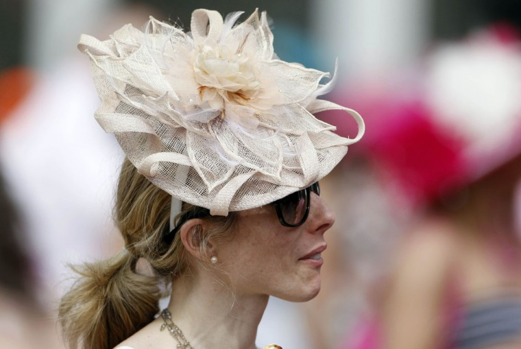 Gretchen Wigan wears a traditional Derby hat before the 2013 Kentucky Oaks at Churchill Downs in Louisville, Kentucky. (Mark Zerof/USA TODAY Sports)