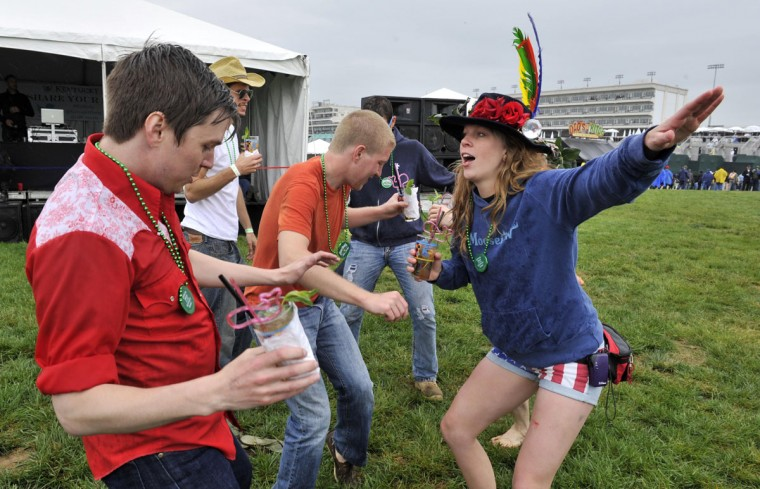 Race fans dance in the infield before the 2013 Kentucky Derby at Churchill Downs in Louisville, Kentucky. (Jamie Rhodes/USA TODAY Sports)