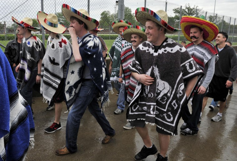 Fans wearing sombreros arrive before the 2013 Kentucky Derby at Churchill Downs in Louisville, Kentucky. (Jamie Rhodes/USA TODAY Sports)