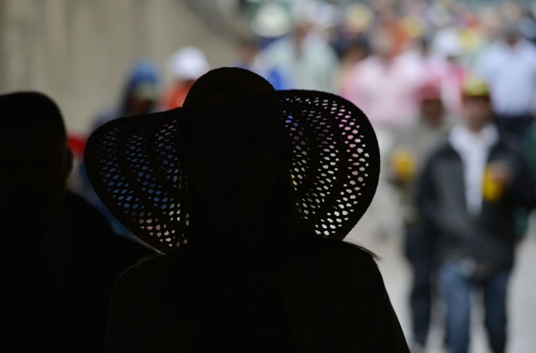 A race fan wearing a Derby hat walks through the pedestrian tunnel to the infield before the 2013 Kentucky Derby at Churchill Downs in Louisville, Kentucky. (Jamie Rhodes/USA TODAY Sports)