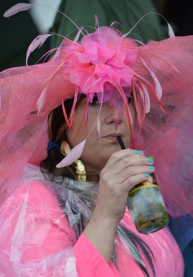 Horse racing fan Aimee Boorse drinks a mint julep in the paddock area before the 2013 Kentucky Derby at Churchill Downs. (Jamie Rhodes/USA TODAY Sports)