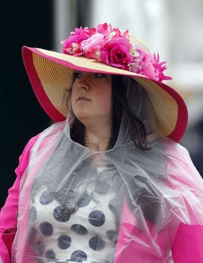 Race fan Karra Logan walks through the paddock area with her Derby hat before the 2013 Kentucky Derby at Churchill Downs. (Mark Zerof/USA TODAY Sports)