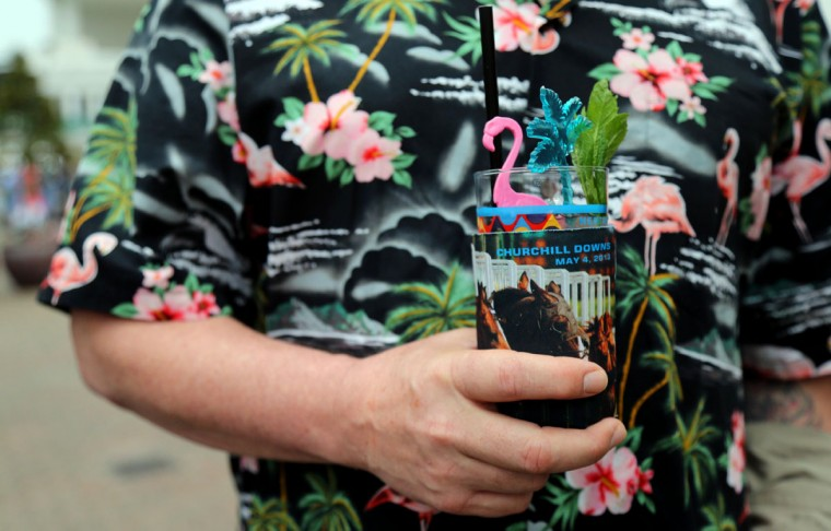 Race fan Scott Beaty holds a mint julep before the 2013 Kentucky Derby at Churchill Downs in Louisville, Kentucky. (Jerry Lai/USA TODAY Sports)