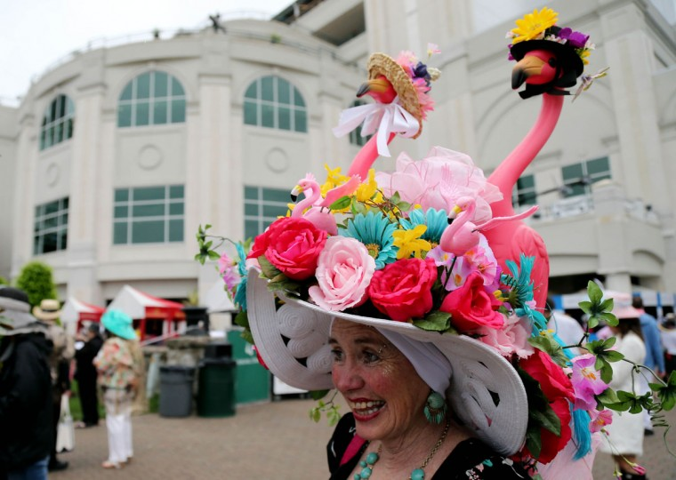 Jan Beaty walks through the paddock area while wearing a Derby hat before the 2013 Kentucky Derby at Churchill Downs in Louisville, Kentucky. (Jerry Lai/USA TODAY Sports)