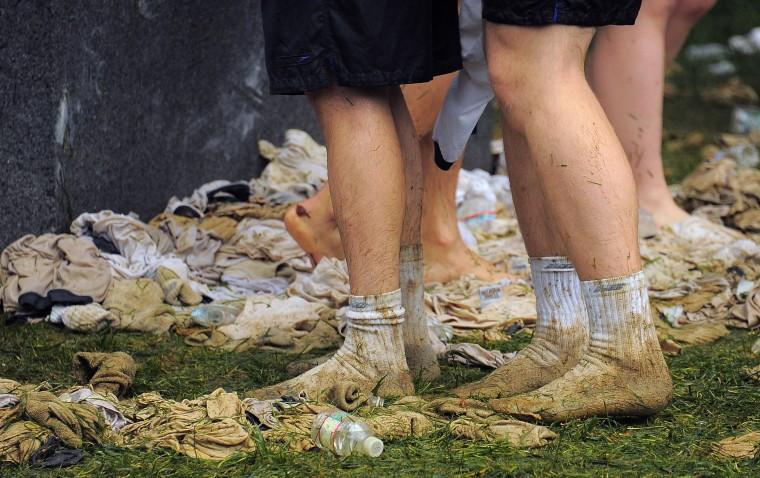 Plebes used their clothing down to their socks to help wipe the lard away. (Karl Merton Ferron/Baltimore Sun)